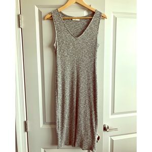 Everly body-con dress with slit in the front!